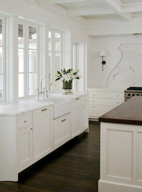 Gilded Interiors white kitchen shaped backsplash