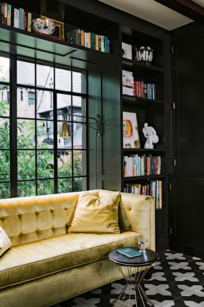 Black shelves yellow couch