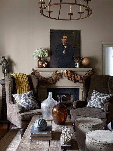 unframed painting above a fireplace