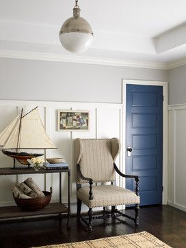 paneling and blue door entry