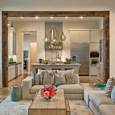 wood beams to separate kitchen and living