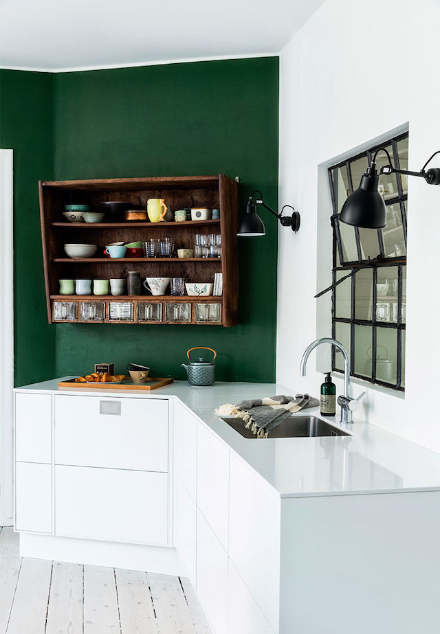green accent wall white kitchen