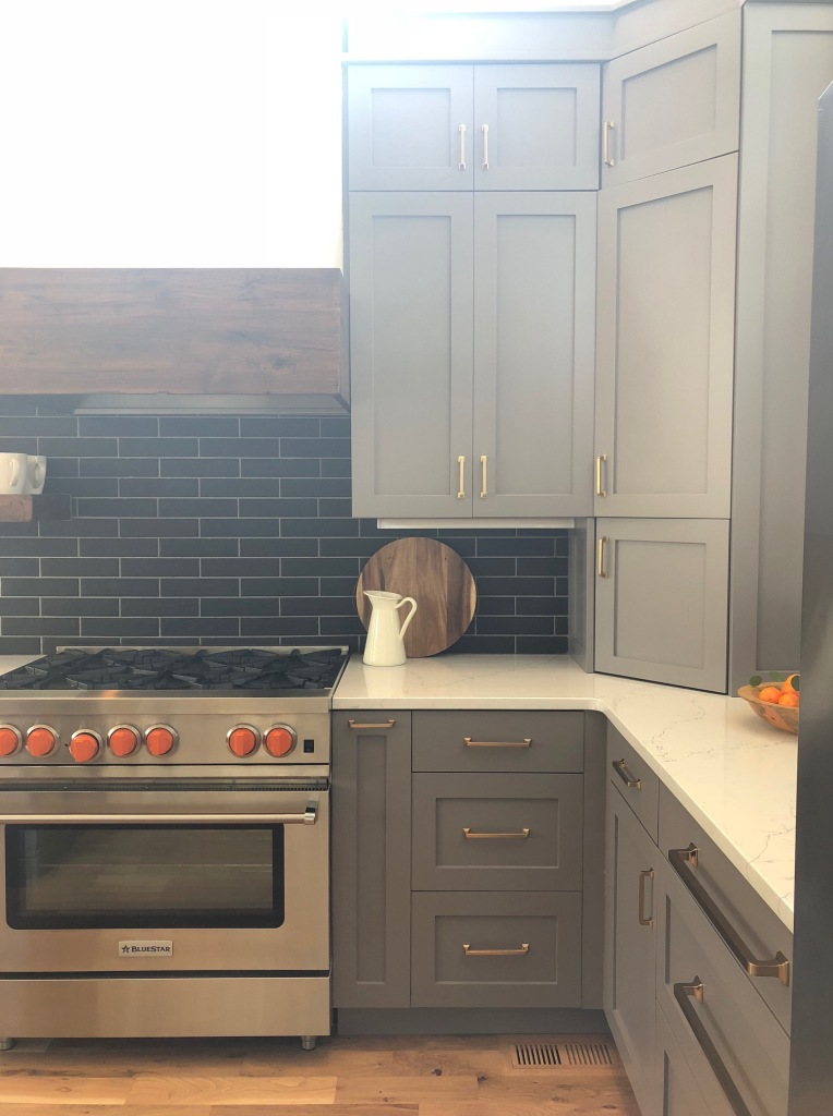 gray kitchen with wood