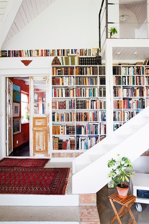 books and a vintage rug