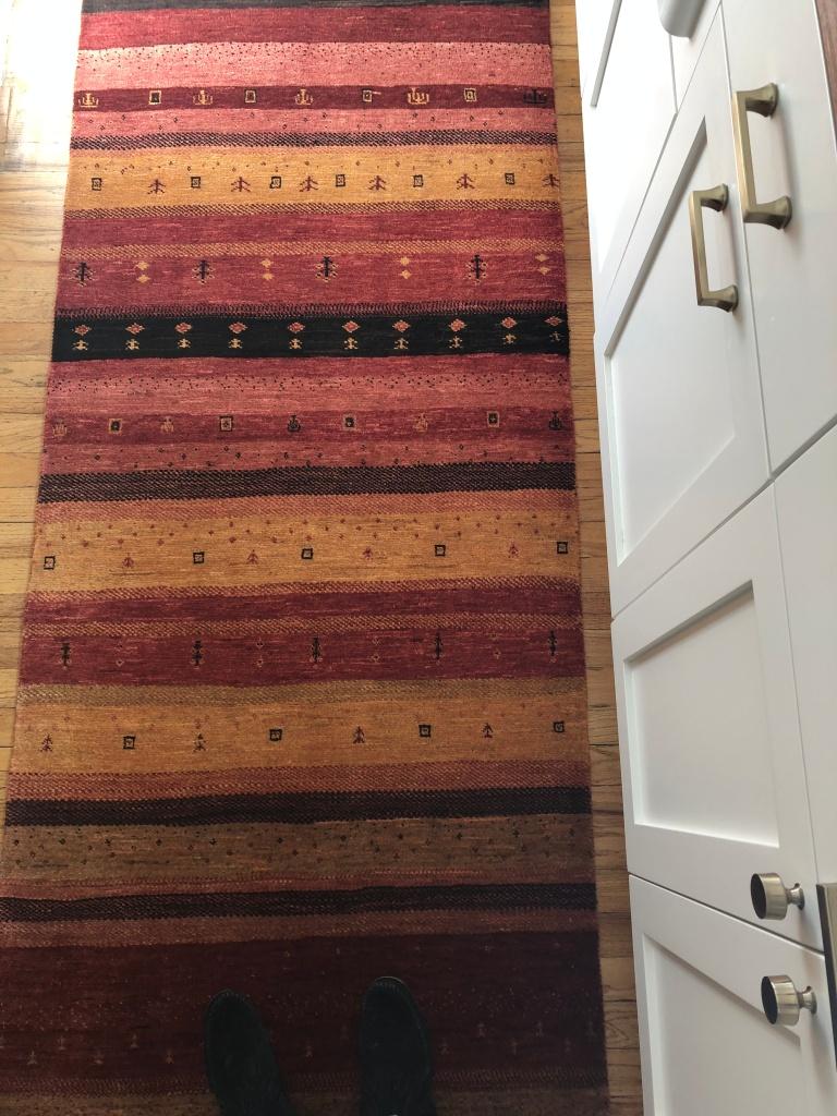 orange pink red rug