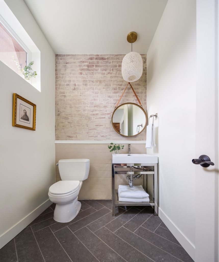 powder room brick wall
