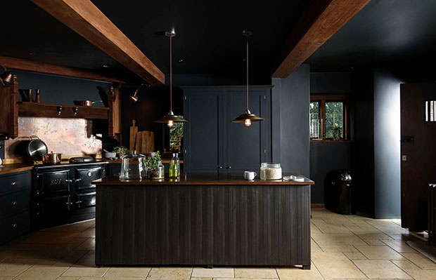 dark moody kitchen with beams
