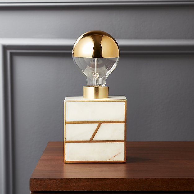 white and brass lamp