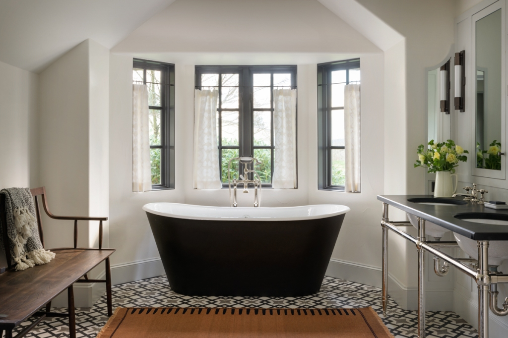 freestanding black tub